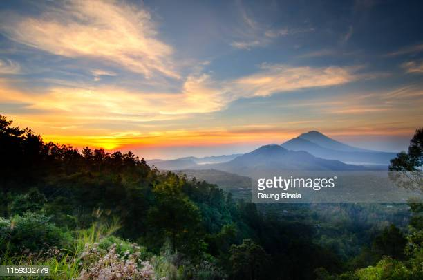 colorful morning in kintamani - lake batur stock photos and pictures