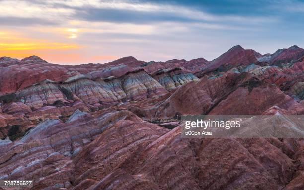 colorful mountains in zhangye national geopark at sunset, zhangye, gansu, china - 甘粛張掖国家地質公園 ストックフォトと画像