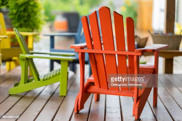 colorful muskoka chairs for people to relax in during the tour. - istock photo stock pictures, royalty-free photos & images