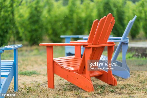 colorful muskoka chairs for people to relax in during the tour. - istock stock-fotos und bilder