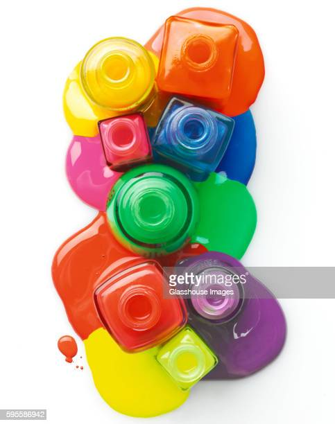 Colorful Nail Polish Spilling From Bottles, High Angle View,