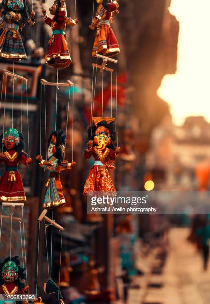 colorful nepalese puppets hanging - カトマンズ ダルバール広場 ストックフォトと画像
