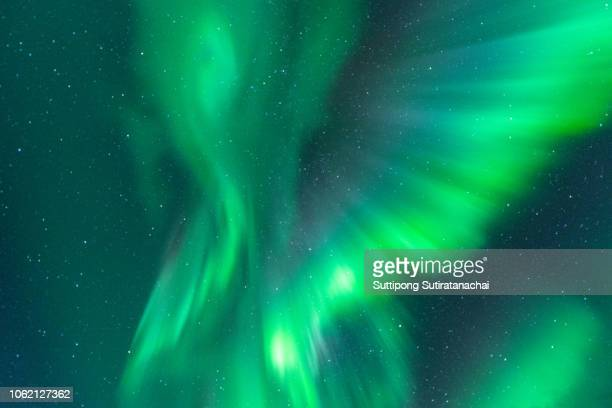 colorful northern lights over starry night sky call aurora borealis - aurora borealis stock pictures, royalty-free photos & images