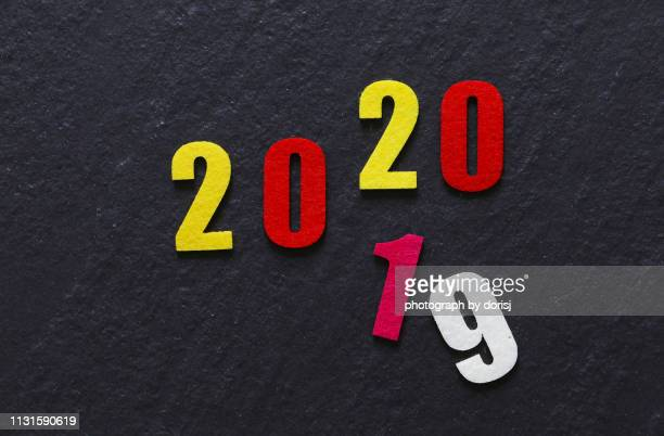 colorful numbers on dark background - 2019 2020 calendar stock pictures, royalty-free photos & images