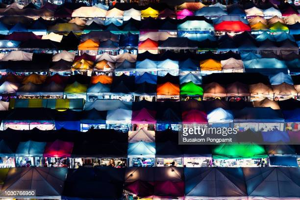 colorful of train night market, abstract background - finanzen und wirtschaft stock-fotos und bilder