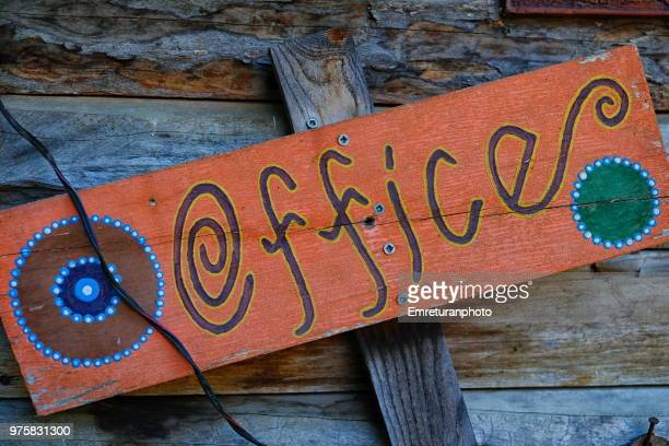 colorful office sign on a wooden wall. - emreturanphoto stock pictures, royalty-free photos & images