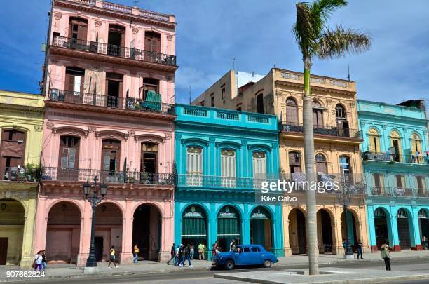 Colorful old cars passing by Plaza de la Fraternidad in Old Havana