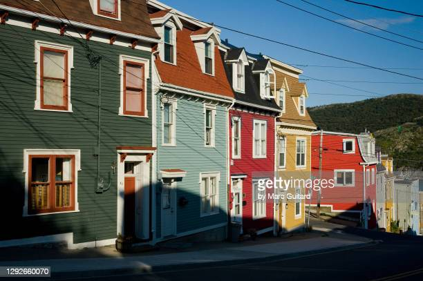 colorful old row houses in downtown st. john's, newfoundland & labrador, canada - canada stock pictures, royalty-free photos & images