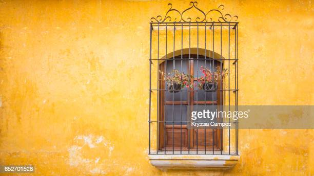 Colorful old wall and window at streets of Antigua Guatemala