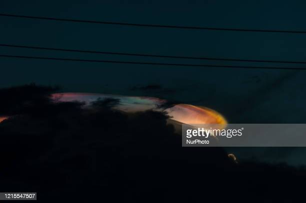 A colorful optical phenomenon called quotCloud Iridescencequot is seen in the sky at sunset at Medan city on May 25 2020 in North Sumatra Indonesia