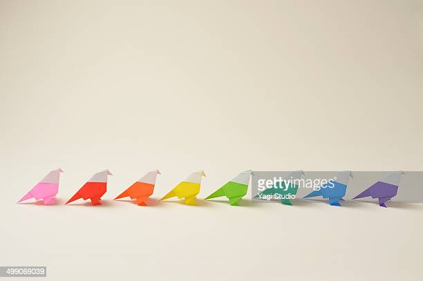 Colorful origami birds in a row