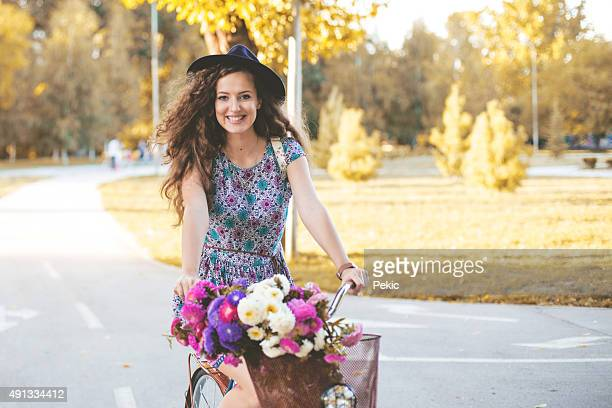Colorful outdoor portrait of young pretty fashion model with bik