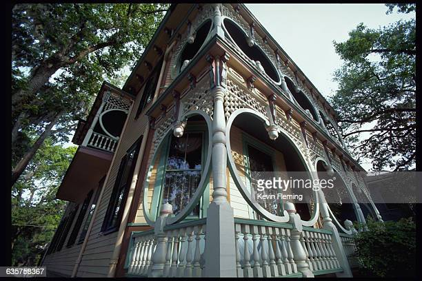 A colorful paint job and the white beaded latticework on this house help to explain its name the 'gingerbread house' Bull Street Savannah Georgia USA