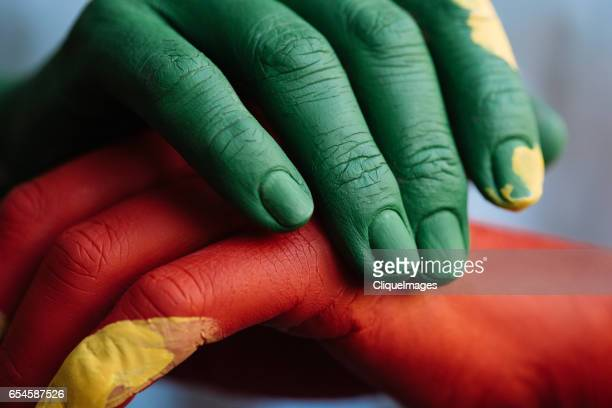 colorful paint on hands - cliqueimages stockfoto's en -beelden