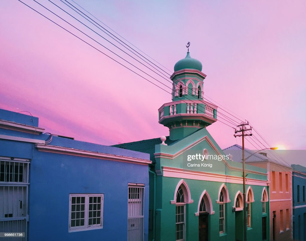 Colorful Painted Houses In Beautiful Pink Sunset Stock Photo | Getty ...
