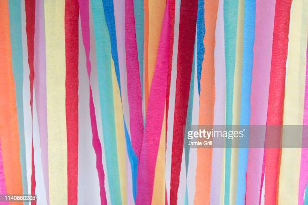 colorful paper streamers - streamer stock photos and pictures