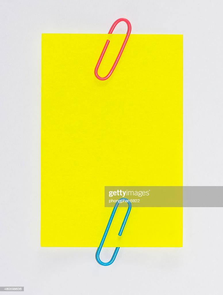 Colorful paperclips and post it on white background isolated : Stock Photo