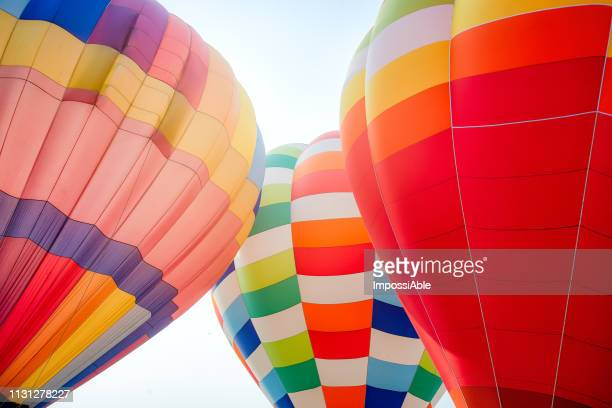 colorful pattern of three balloons outdoor with the bright sky background