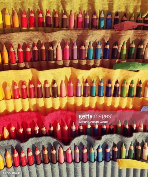 colorful pencils in textile support - cristian neri foto e immagini stock