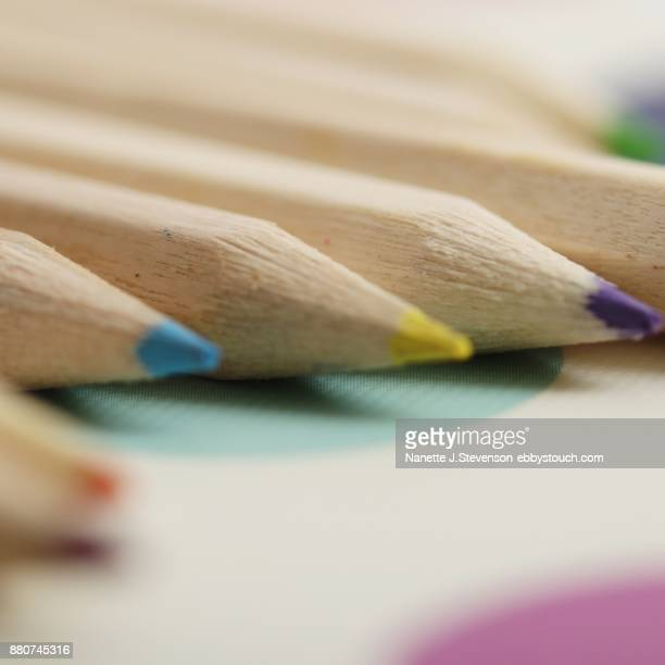 colorful pencils on colorful background - nanette j stevenson stock photos and pictures