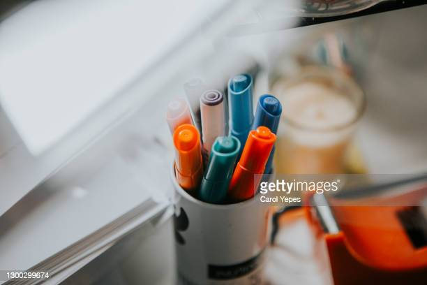 colorful pens on pen container in student table at home - school cane stock pictures, royalty-free photos & images
