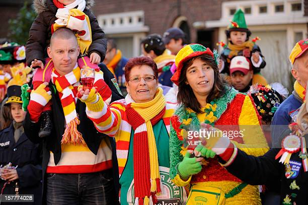 Colorful people watching the annual carnival parade in 's Hertogenbosch
