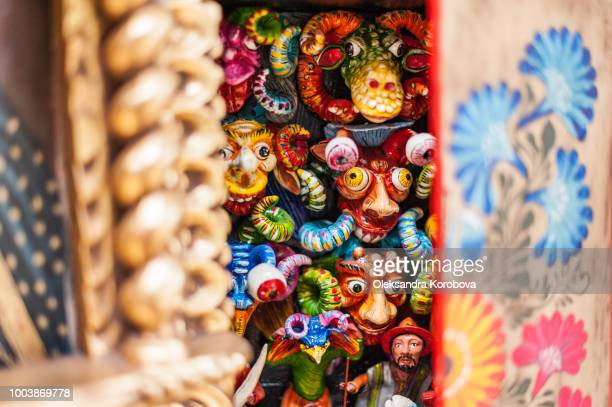 colorful peruvian ceramic sculptures at a market in south america. - lima animal stock pictures, royalty-free photos & images