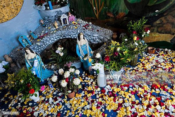Colorful petals cover the floor in the shrine of Yemanjá, the goddess of the sea, on 07 February 2012 in Rio Vermelho, Salvador, Bahia, Brazil....