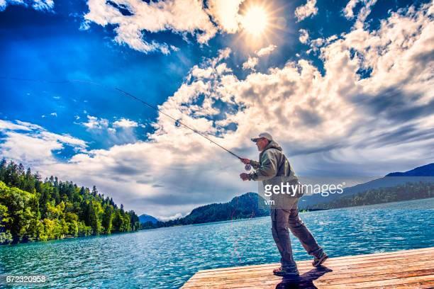 フライ漁師の彼の棒を鋳造のカラフルな写真