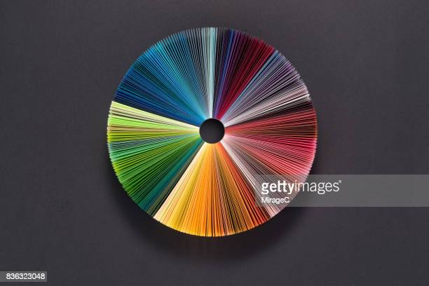 colorful pie chart consists of paper pages - konzepte und themen stock-fotos und bilder