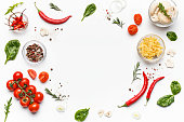 Colorful pizza ingredients on white background, top view