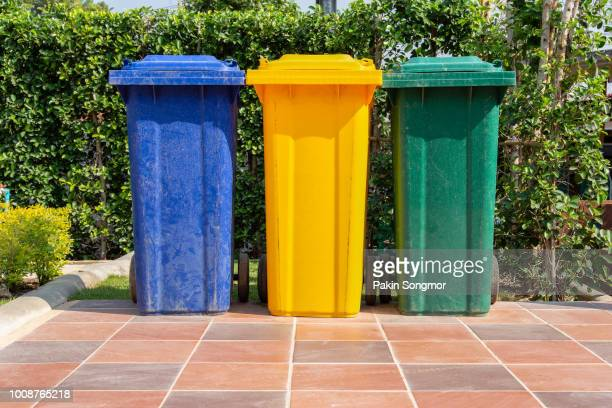 colorful plastic bins for different waste types - garbage can stock photos and pictures