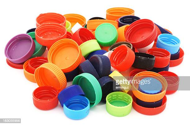 Colorful plastic caps pile isolated in white