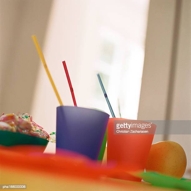 Colorful plastic cups with straws.