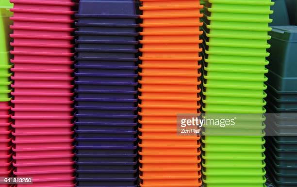 Colorful plastic planters stacked in orderly manner