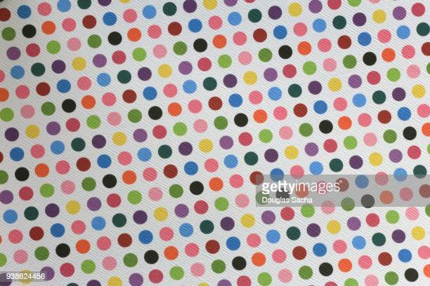 Colorful polka dot pattern on white background