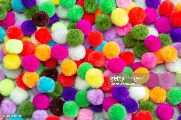 a colorful pom pom background - hairy balls stock photos and pictures