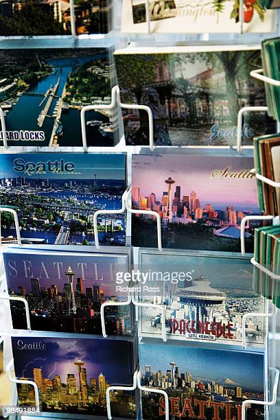 colorful postcards of seattle on a rack - postcard stock pictures, royalty-free photos & images