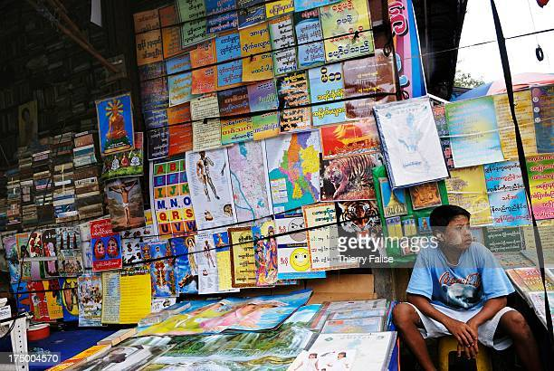 Colorful posters selling at the book stand in downtown Yangon