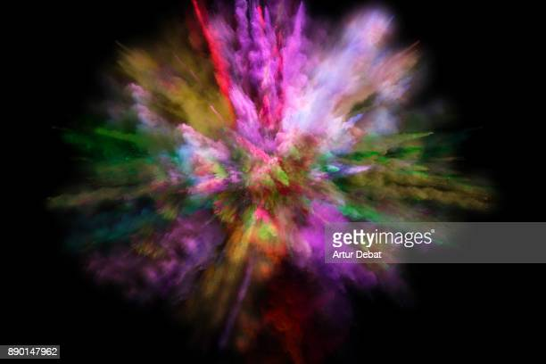 Colorful powder explosion in all directions in a nice composition with vivid colors and black background.