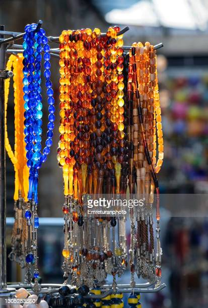colorful prayer beads for sale on a market stand. - emreturanphoto stock pictures, royalty-free photos & images