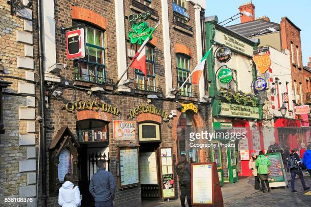 Colorful pub exteriors flags and beer signs Temple bar area Dublin city center Ireland Republic of Ireland