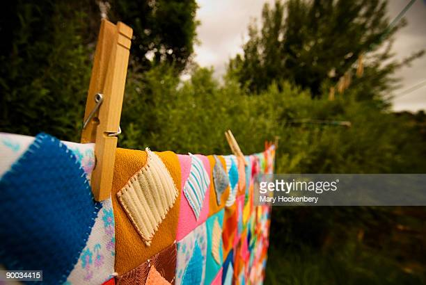 A colorful quilt on a country clothesline