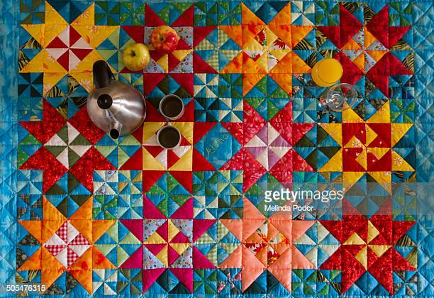 colorful quilt used as breakfast/tea time spread - キルト ストックフォトと画像