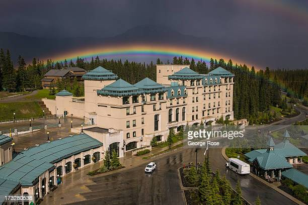 A colorful rainbow forms over the Fairmont Chateau Lake Louise Convention Center on June 27 2013 in Lake Louise Alberta Canada Major flooding along...