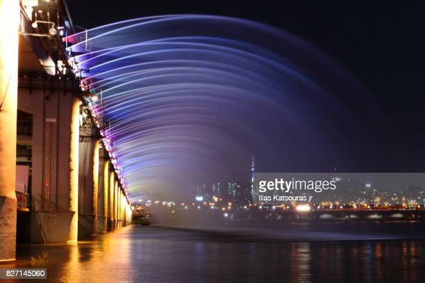 Colorful rainbow fountain at the side of Banpo bridge at night