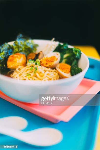 colorful ramen bowls at a japanese pub - mmeemil stock photos and pictures