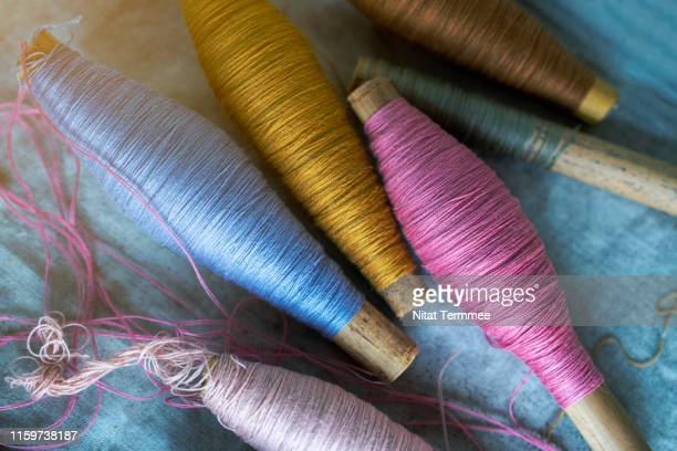 colorful raw silk thread to work natural textile fiber art of the household industry. can be seen in the countryside of thailand. - 刺繍 ストックフォトと画像