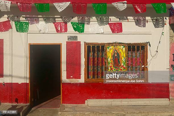 Colorful red and white storefront in Celestun, Mexico in Yucatan Peninsula, Mexico