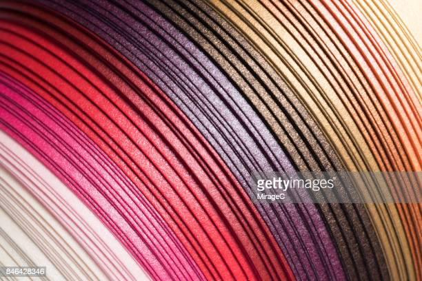 colorful red shiny texture paper stripes - buchseite stock-fotos und bilder
